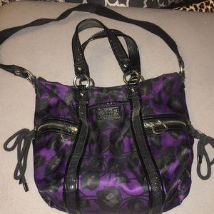 Coach purple purse with black cheetah print